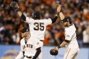 San Francisco Giants' Pagan Celebrates With Teammates Crawford And Pence After The Giants Defeated The Detroit Tigers In Game 2 Of The MLB World Series Baseball Championship In San Francisco