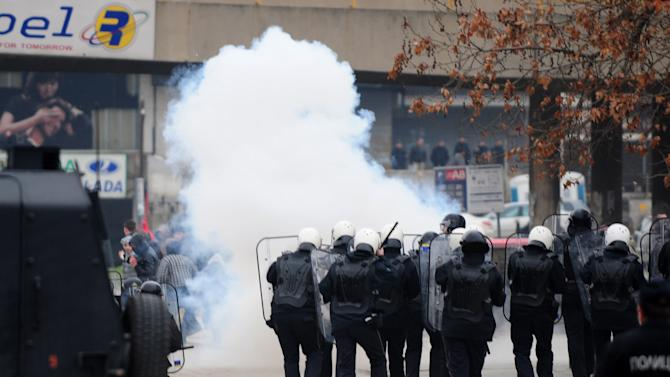 The police use tear gas as a group of ethnic Albanians throw stones at them, during a violent protest of a group of ethnic Albanians in Skopje, Macedonia, Saturday, March 2, 2013. Hundreds of ethnic Albanians staged a contra-protest on Saturday to express support for the designation of the new defense minister. Police said Saturday at least 20 people, from whom 13 police officers and other mainly youngsters were injured in a series of scuffles that erupted late on Friday and continued over night when a group of a few hundred Macedonians started a protest against the designation of a new defense minister Talat Xhaferi, an ethnic Albanian and former rebel commander. (AP Photo/Vangel Tanurovski)