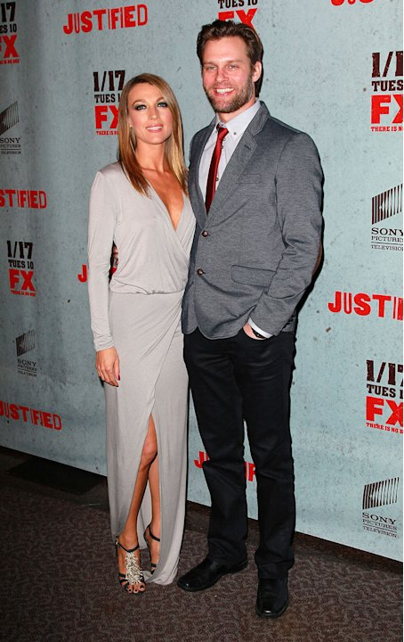 "Natalie Zea and Travis Schuldt attend the Season 3 premiere of FX's ""Justified"" at the Directors Guild on January 10, 2012 in Los Angeles, California."