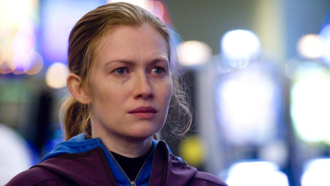 """FILE - In this publicity file photo released by AMC, Mireille Enos is shown in a scene from """"The Killing.""""  Enos and her co-star Joel Kinnaman failed to snag an Emmy nomination on Thursday, July 19, 2012, for their roles in the popular murder series. (AP Photo/AMC, Carole Segal, File)"""