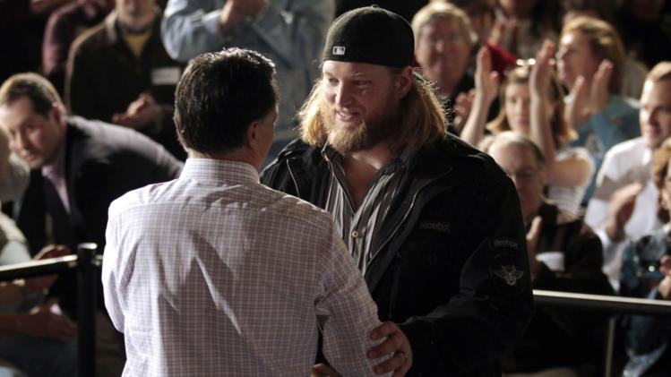 Mangold introduces Republican presidential candidate and former Massachusetts Governor Romney at a town hall meeting campaign stop at USAeroteam in Dayton