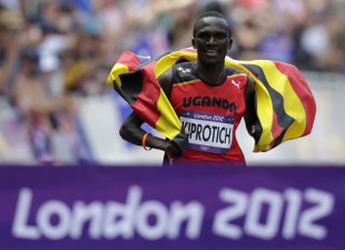 Stephen Kiprotich approaches the finish line to win the men's marathon (REUTERS)