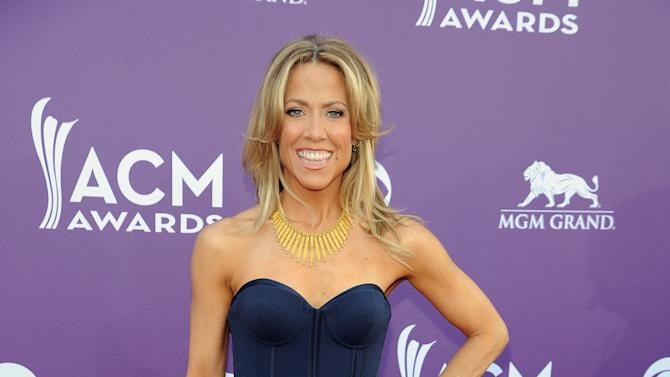 Singer Sheryl Crow arrives at the 48th Annual Academy of Country Music Awards at the MGM Grand Garden Arena in Las Vegas on Sunday, April 7, 2013. (Photo by Al Powers/Invision/AP)