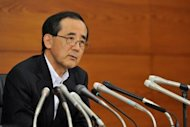 Bank of Japan (BOJ) governor Masaaki Shirakawa answers questions during a press conference in Tokyo. The Bank of Japan followed its US and European counterparts Wednesday, announcing extra bond buying to take its total monetary easing effort past $1 trillion as it seeks to revitalise the economy