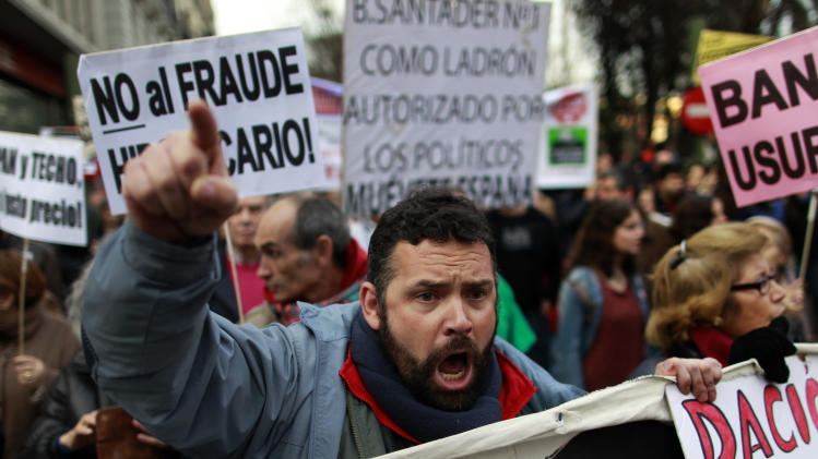 A demonstrator shout slogans to change mortgage laws and halt evictions of those unable to pay mortgages in Madrid, Saturday, Feb. 16, 2013. The government agreed to consider changes to the law on mortgages after pressure from opposition parties and a growing public outcry, including a petition that was signed by 1.4 million people – enough signatures to force Parliament to discuss alterations to the law in a special session. (AP Photo/Andres Kudacki)