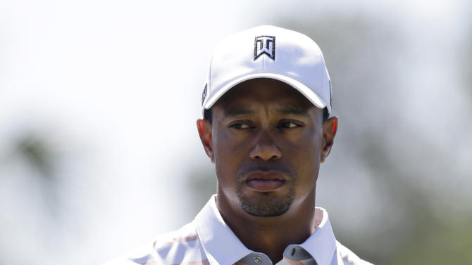 Tiger Woods waits to hit from the third tee during the second round of the Cadillac Championship golf tournament Friday, March 8, 2013, in Doral, Fla. (AP Photo/Wilfredo Lee)
