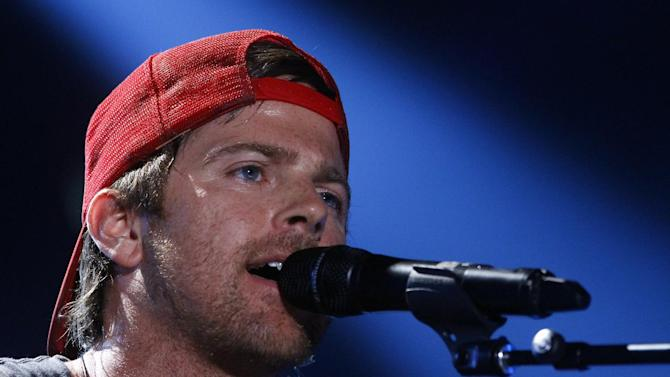 FILE - This June 7, 2013 file photo shows Kip Moore on day 2 of the 2013 CMA Music festival at the LP Field in Nashville, Tenn. Moore, along with Brett Eldredge, and Justin Moore are vying for the fan-voted best new artist award at the Academy of Country Music Awards on Sunday, April 6, 2014, in Las Vegas. (Photo by Wade Payne/Invision/AP, File)