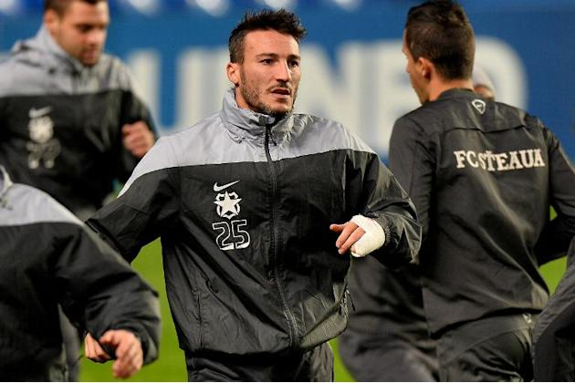 Steaua Bucharest's Federico Piovaccari warms up during a training session at Stamford Bridge in London, on December 10, 2013, on the eve of their UEFA Champions League Group E match against Chelse