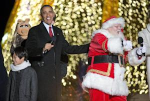 President Barack Obama with Santa Claus and other performers …