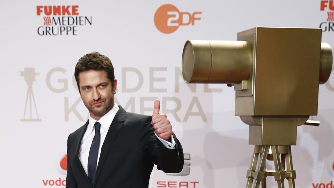 Actor Butler arrives on red carpet for Golden Camera awards ceremony in Hamburg