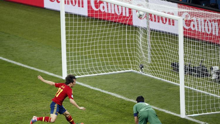 Spain's David Silva, left, scores the opening goal past Italy goalkeeper Gianluigi Buffon, right, during the Euro 2012 soccer championship final  between Spain and Italy in Kiev, Ukraine, Sunday, July 1, 2012. (AP Photo/Darko Vojinovic)