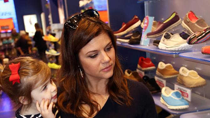 """Tiffani Thiessen, left, and her adorable daughter, Harper, picked up BOBS from SKECHERS shoes during a holiday shopping trip in Santa Monica, Calif. on Dec. 9, 2012.  To date, the BOBS """"buy a pair give a pair"""" charitable program has donated more than 3 million pairs of new shoes to children in need around the world. (Photo by Matt Sayles/Invision for Skechers/AP Images)"""