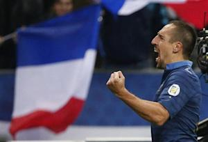France's Ribery celebrates after scoring against Finland during the 2014 World Cup qualiying soccer match at the Stade de France stadium in Saint-Denis