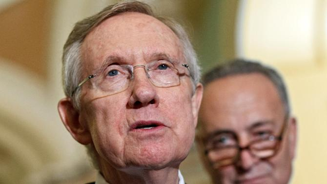 Senate Majority Leader Harry Reid, D-Nev., speaks to reporters just after Senate Democrats passed their version of a yearlong tax cut extension bill by a near party-line 51-48 vote, at the Capitol in Washington, Wednesday, July 25, 2012. At right is Sen. Charles Schumer, D-N.Y. (AP Photo/J. Scott Applewhite)