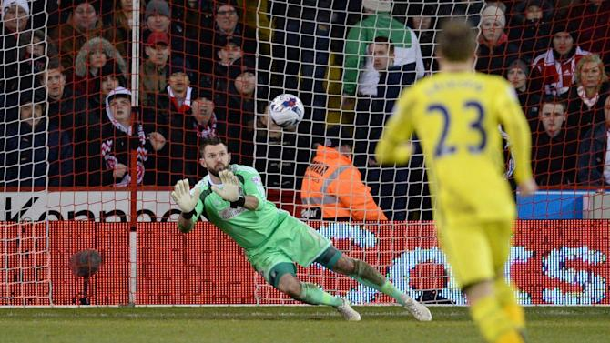 Sheffield United's English goalkeeper Mark Howard saves a shot during the English League Cup semi-final second leg football match between Sheffield United and Tottenham Hotspur in Sheffield, England, on January 28, 2015