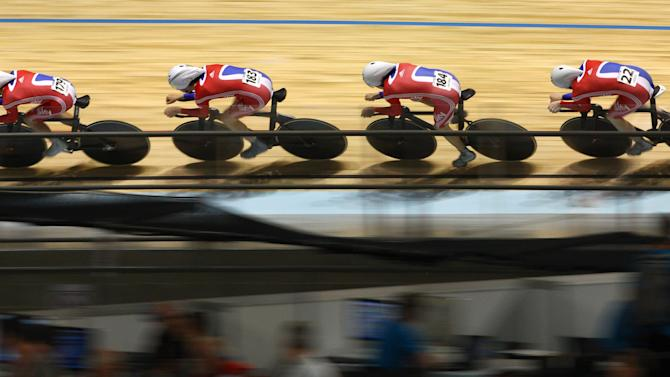 Great Britain's, left to right, Peter Kennaugh, Andrew Tennant, Geraint Thomas and Ed Clancy race during qualifying in the men's team pursuit at the Track Cycling World Championships in Melbourne, Australia, Wednesday, April 4, 2012. (AP Photo/Rick Rycroft)