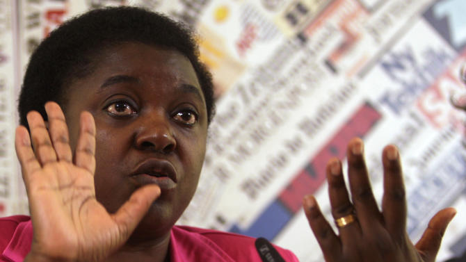 """Italian Integration Minister Cecile Kashetu Kyenge speaks during a press conference at the Foreign Press Club in Rome, Wednesday, June 19, 2013. Kyenge on Wednesday acknowledged """"racist episodes"""" in Italy but declined to brand the country as a whole racist. She has so far tempered her reaction to racist attacks, saying it's for Italians to respond, not her. (AP Photo/Domenico Stinellis)"""