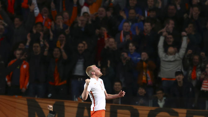 Netherlands' Davy Klaassen celebrates after scoring during an international friendly soccer match between Netherlands and Spain at ArenA stadium in Amsterdam, Netherlands, Tuesday, March 31, 2015. (AP Photo/Peter Dejong)