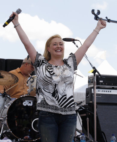 FILE - In this June 5, 2008 file photo, country music artist Mindy McCready performs at the CMA Music Festival in Nashville, Tenn. McCready, who hit the top of the country charts before personal problems sidetracked her career, died Sunday, Feb. 17, 2013. She was 37. (AP Photo/Bill Waugh, File)