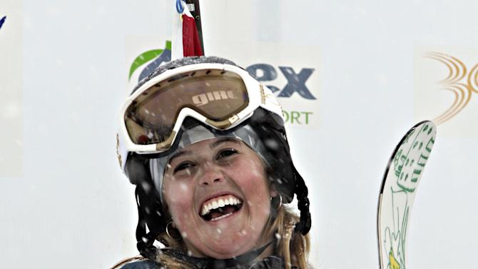FILE - In this March 17, 2006, file photo, Sarah Burke of Canada, smiles as she celebrates her gold medal in the halfpipe FIS world Cup event Friday, March 17, 2006 at Apex Mountain in Penticton, British Columbia.  Burke died Thursday, Jan. 19, 2012,  nine days after crashing at the bottom of the superpipe during a training run in Utah. She was 29. Burke was injured Jan. 11 while training at a personal sponsor event at the Park City Mountain resort. (AP Photo/The Canadian Press,  Jacques Boissinot)