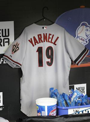 A jersey honoring the 19 firefighters who died in the wildfire in Yarnell, Ariz., hangs in the Arizona Diamondback's dugout before the baseball game against the New York Mets at Citi Field, Monday, July 1, 2013 in New York. The firefighters died Sunday. (AP Photo/Seth Wenig)