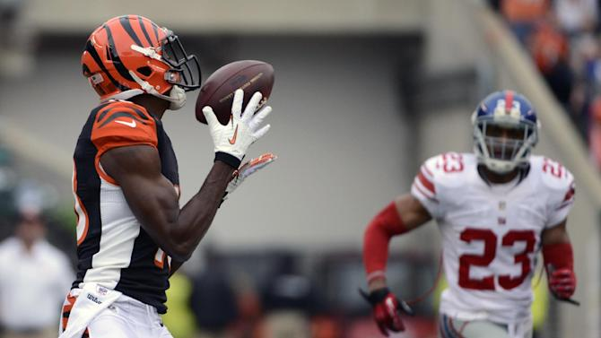 Cincinnati Bengals wide receiver A.J. Green, left, catches a 56-yard touchdown pass against New York Giants cornerback Corey Webster (23) in the first half of an NFL football game on Sunday, Nov. 11, 2012, in Cincinnati. (AP Photo/Michael Keating)