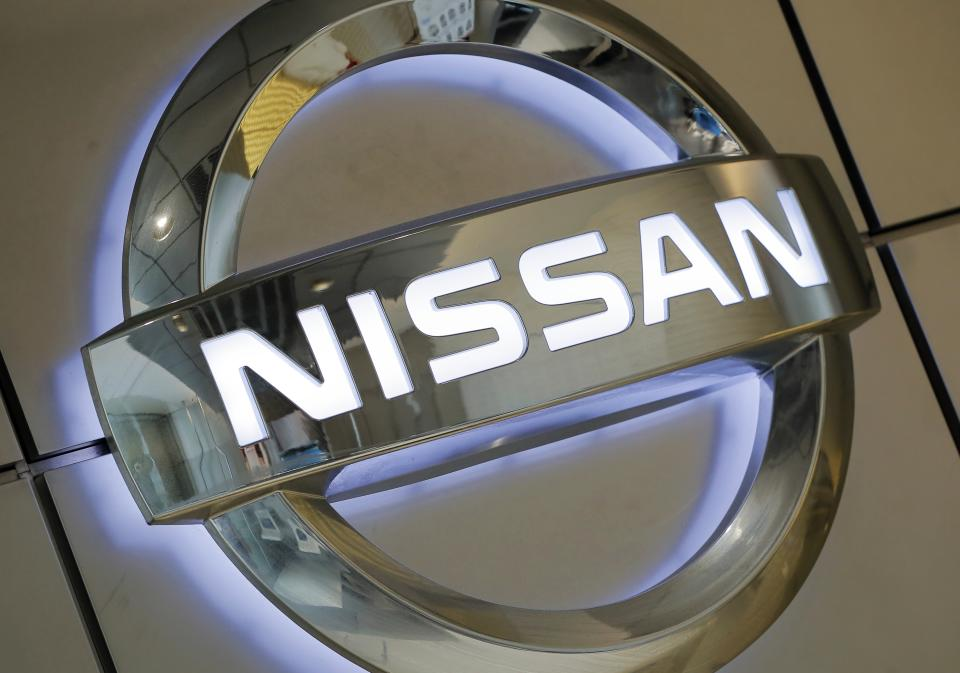 Nissan cuts profit outlook, revamps management