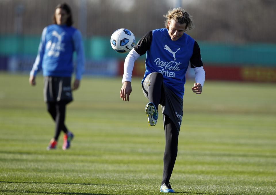 Uruguay's Diego Forlan kicks a ball during a training session in Buenos Aires, Argentina, Thursday, July 21, 2011. Uruguay will face Paraguay on July 24 for the final Copa America soccer match. (AP Photo/Natacha Pisarenko)