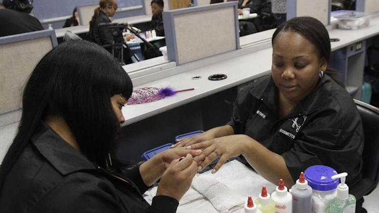 "Shaqualana Tolefree, left, paints the nails of Jamea Daggs during class after a news conference at the Laney College School of Cosmetology in Oakland, Calif., Tuesday, April 10, 2012. Some nail polishes commonly found in California salons and advertised as free of a so-called ""toxic trio"" of chemicals actually have high levels of agents known to cause birth defects,according to state chemical regulators. (AP Photo/Jeff Chiu)"