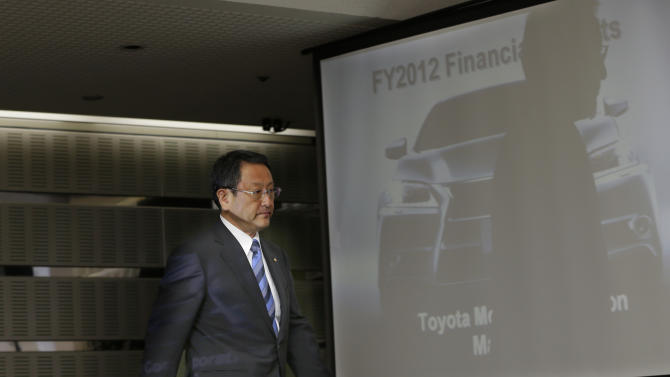 Toyota Motor Corp. President Akio Toyoda arrives for a news conference at the automaker's headquarters in Tokyo Wednesday, May 9, 2012. Toyota's January-March profit more than quadrupled to 121 billion yen ($1.5 billion), and the automaker gave upbeat forecasts, marking a solid recovery from a hardship-filled year following the tsunami in Japan. Toyota's profit for the fiscal year ended March plunged 30 percent to 283.6 billion yen ($3.5 billion), down from 408 billion yen the previous fiscal year, as last year's tsunami damaged supply chains in northeastern Japan and hobbled Toyota production around the world. (AP Photo/Shizuo Kambayashi)