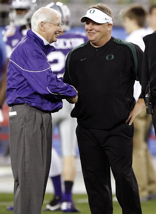 Kansas State head coach Bill Snyder, left, shakes hands with Oregon head coach Chip Kelly before the Fiesta Bowl NCAA college football game, Thursday, Jan. 3, 2013, in Glendale, Ariz. (AP Photo/Paul C