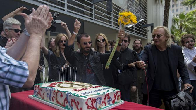 "Musician Ringo Starr gestures during a ""Peace & Love"" event in Los Angeles"