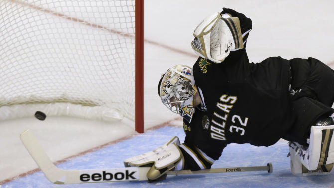 Dallas Stars goalie Kari Lehtonen can't stop a shot for a goal by Phoenix Coyotes center Martin Hanzal during the second period of an NHL hockey game Saturday, Jan. 19, 2013, in Dallas. (AP Photo/LM Otero)