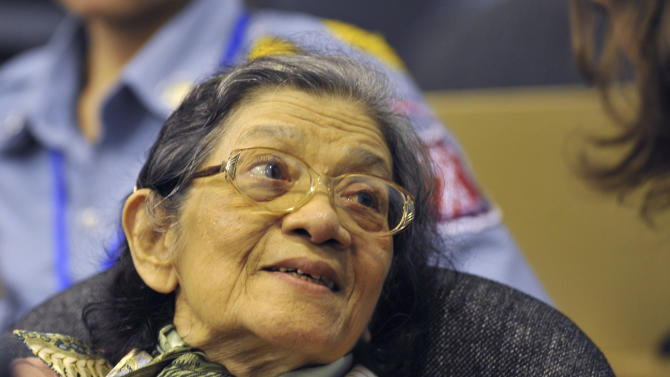 In this photo taken on Oct. 19, 2011 released by the Extraordinary Chambers in the Courts of Cambodia, Ieng Thirith, foreground, the Khmer Rouge's former minister of social affairs, smiles during a hearing in Phnom Penh, Cambodia. Ieng Thirith will be set free after a court in Cambodia ruled Thursday, Sept. 13, 2012, that she was medically unfit to stand trial for genocide, a decision survivors called shocking and unjust.  (AP Photo/Extraordinary Chambers in the Courts of Cambodia, Mark Peters)