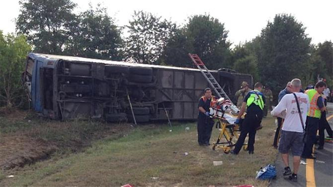 1 dead, dozens injured when tour bus overturns in New Castle County