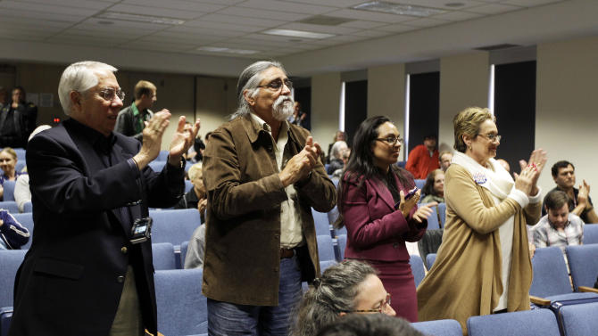 The audience applauds Mariela Castro, daughter of Cuban President Raul Castro, after she spoke at an academic conference at San Francisco General Hospital in San Francisco, Wednesday, May 23, 2012. Castro, an outspoken gay rights advocate, spoke at a medical lecture for health care providers on care for transgender patients. (AP Photo/Eric Risberg)