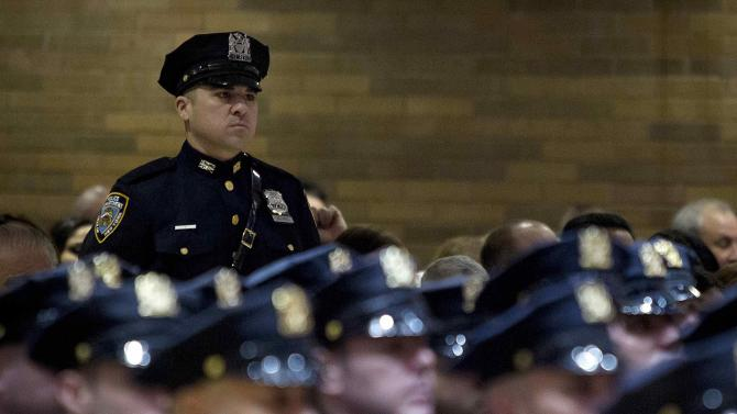 Police officers take part in a New York Police Department Promotion Ceremony at Police Headquarters in the Manhattan borough of New York