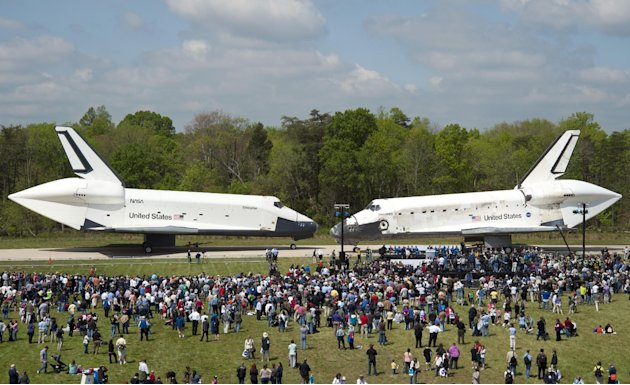 In this photo provided by the Smithsonian Institution via NASA, space shuttles Enterprise, left, and Discovery meet nose-to-nose at the beginning of a transfer ceremony at the Smithsonian's Steven F.