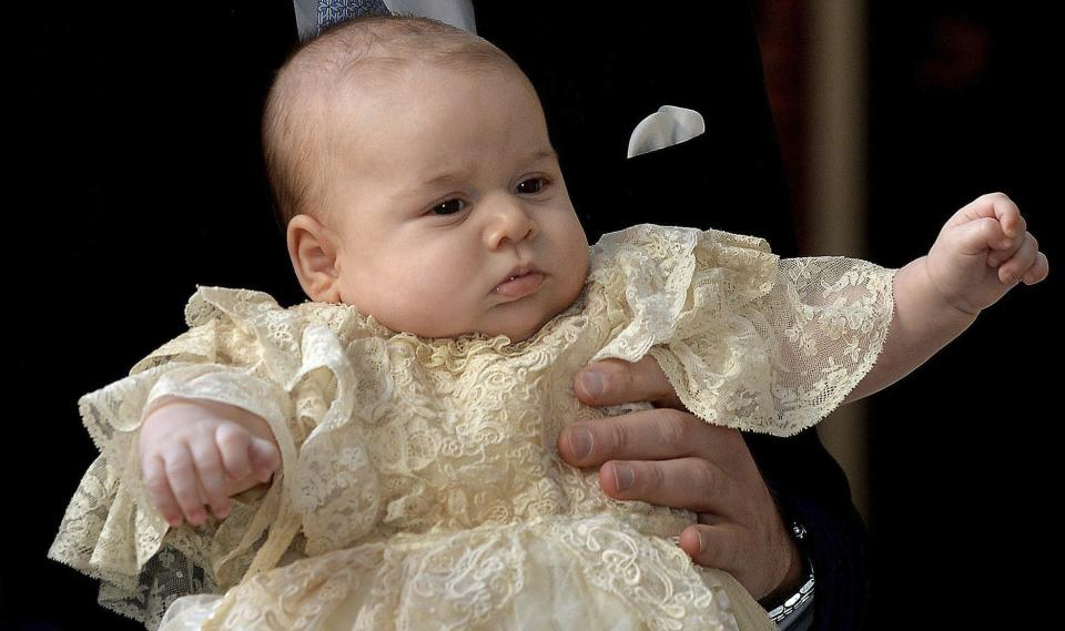 Britain's Prince George is held by his father Prince William as they arrive at Chapel Royal in St James's Palace in London, for the christening of the three month-old Prince Wednesday Oct. 23, 2013. (AP Photo/John Stillwell/Pool)