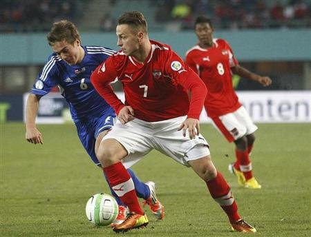 Arnautovic of Austria and Hansson of Faroe Islands fight for the ball during their 2014 World Cup qualifying soccer match in Vienna