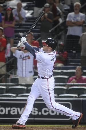 Atlanta Braves' Freddie Freeman (5) connects on a twinning wo run homer against the New York Mets during the ninth inning of a baseball game, Monday, June 17, 2013, in Atlanta. Atlanta won 2-1 (AP Photo/John Amis)