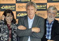 "Actor Harrison Ford (C) poses with actress Karen Allen and film producer George Lucas during the Toyko premiere of their film, ""Indiana Jones and the Kingdom of the Crystal Skull,"" in 2008. A Belize archeologist is suing the makers of the fillm for using a likeness of a so-called Crystal Skull, which he says is a stolen national treasure"