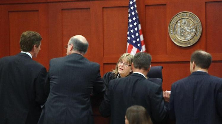Judge Debra Nelson, center, speaks to counsel during George Zimmerman's trial in Seminole circuit court in Sanford, Fla. Wednesday, June 26, 2013. Zimmerman has been charged with second-degree murder for the 2012 shooting death of Trayvon Martin.(AP Photo/Orlando Sentinel, Jacob Langston, Pool)
