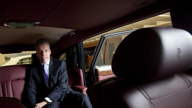 Oetvoes, CEO of Rolls-Royce Motor Cars Ltd., poses for photos after an interview at a showroom in Hong Kong