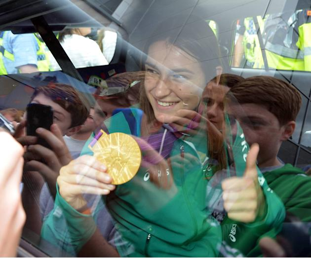Katie Taylor Medal winners from the Irish Olympic team arrive at Dublin Airport after returning home from the London 2012 Olympic Games Dublin, Ireland - 13.08.12 Mandatory Credit: WENN.com