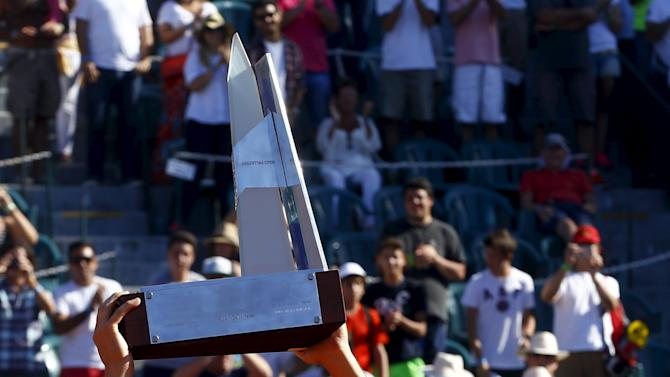 Austria's Thiem holds up a trophy after defeating Spain's Almagro in men's singles match at the ATP Argentina Open tennis tournament in Buenos Aires