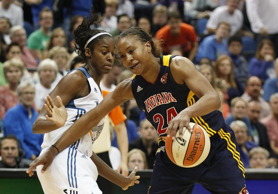 Indiana Fever forward Tamika Catchings (24) pushes the ball around Minnesota Lynx forward Devereaux Peters (14) in the second half of Game 2 of the WNBA basketball Finals Wednesday, Oct. 17, 2012, in Minneapolis. The Lynx won 83-71. (AP Photo/Stacy Bengs)