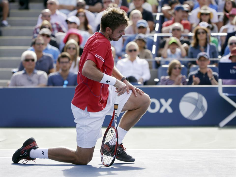Stanislas Wawrinka, of Switzerland, of Switzerland, gets up off the court after falling during a point to Novak Djokovic, of Serbia, during the semifinals of the 2013 U.S. Open tennis tournament, Saturday, Sept. 7, 2013, in New York. (AP Photo/David Goldman)