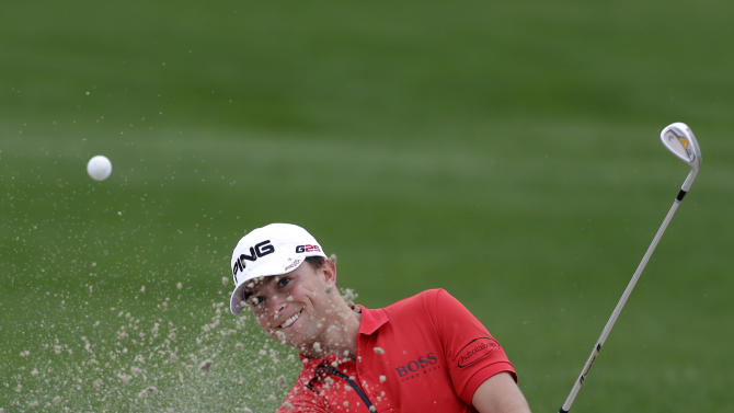 Luke Guthrie hits out of a bunker on the ninth hole during the second round of the Honda Classic golf tournament, Friday, March 1, 2013, in Palm Beach Gardens, Fla. (AP Photo/Wilfredo Lee)