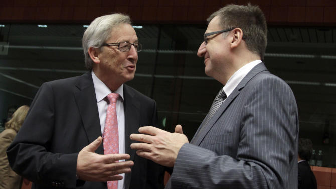 Belgium's Finance Minister Steven Vanackere, right, speaks with Luxembourg's Prime Minister Jean-Claude Juncker during a meeting of EU finance ministers in Brussels on Monday, Jan. 23, 2012. European finance ministers will try on Monday to give new momentum to talks on a Greek debt relief deal that is crucial to avoid a default, but a European diplomat warned that a final agreement may have to wait until a leaders' summit next week. (AP Photo/Virginia Mayo)